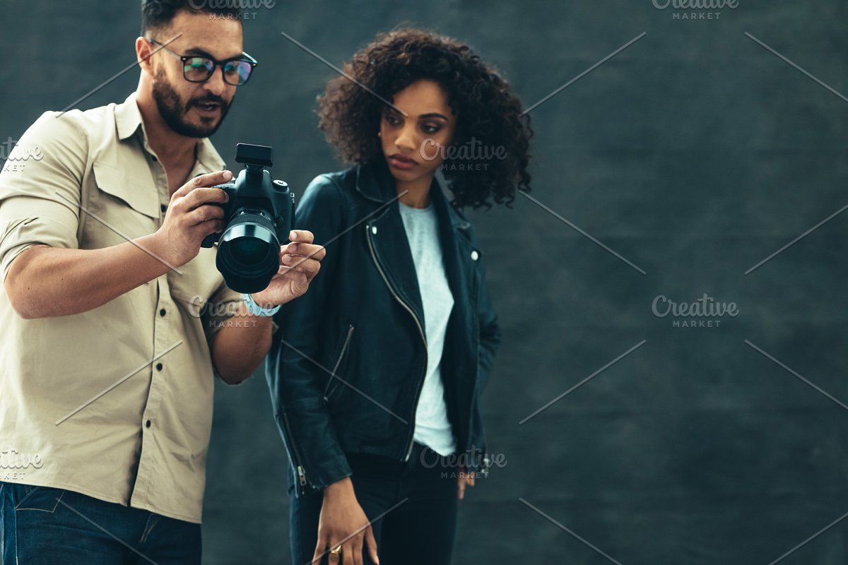 Photo of Photographer showing image in camera #Sponsored , #Paid, #female#model#photo#Pho…