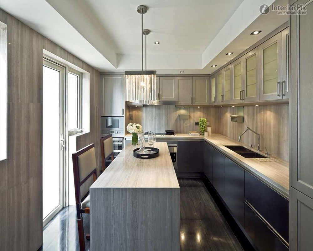 The layout of this contemporary kitchen is wholly rectangular, featuring  green-gray granite countertops