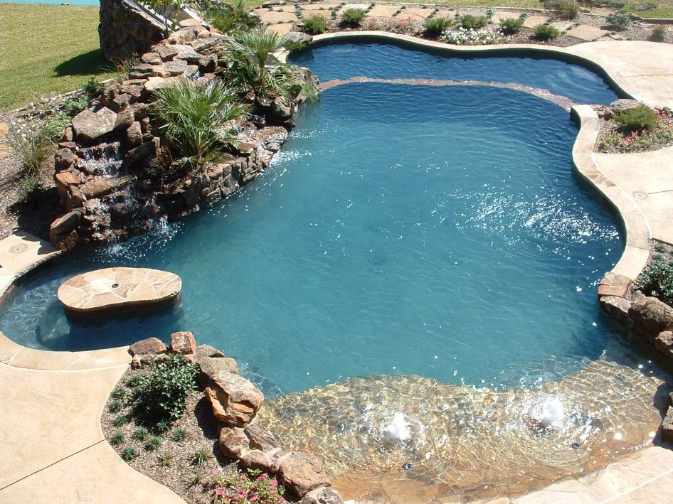 Natural rock swimming pools natural looking swimming for Natural rock swimming pools