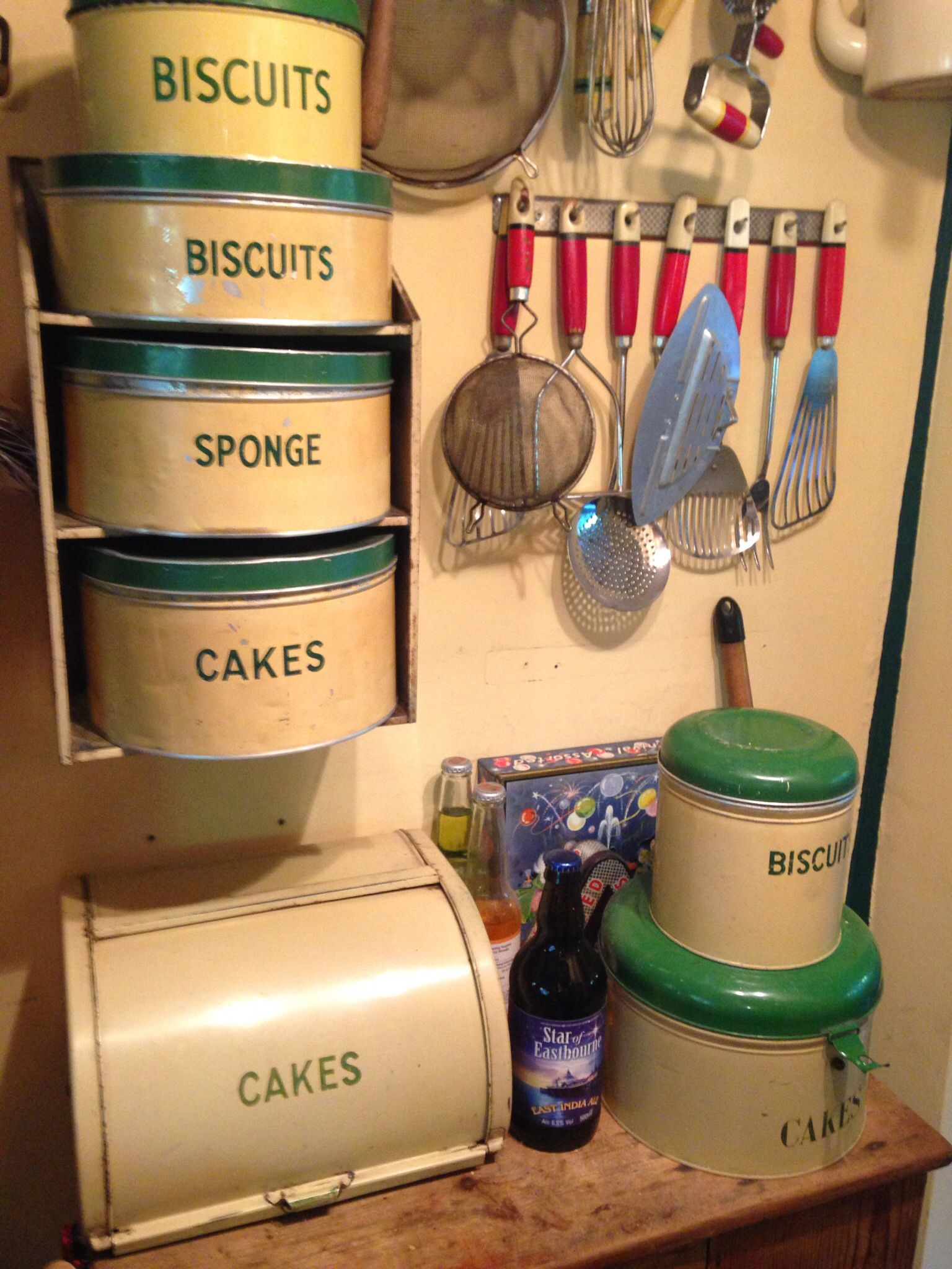 Old Tins And Utensils And A Bottle Of Harveys
