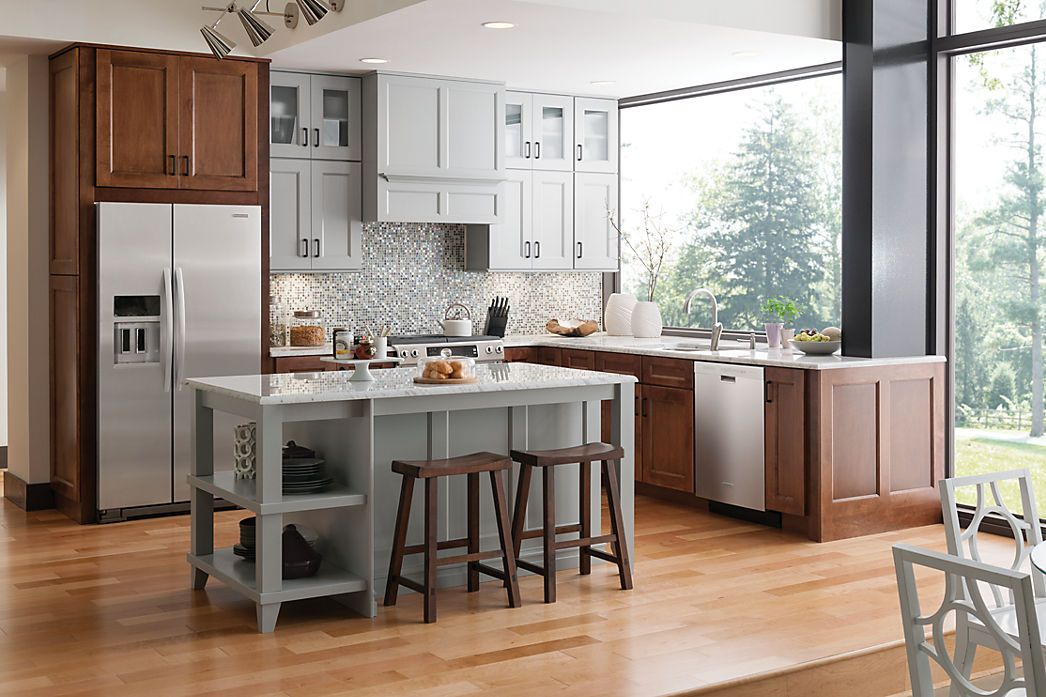 Base Cabinetry And Refigerator Area In Providence Maple
