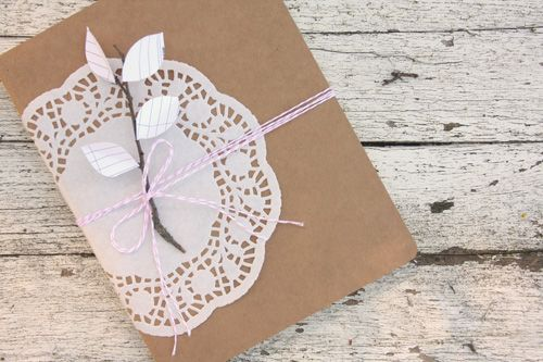 Use heart shaped doilies to add elegance to simple brown wrapping