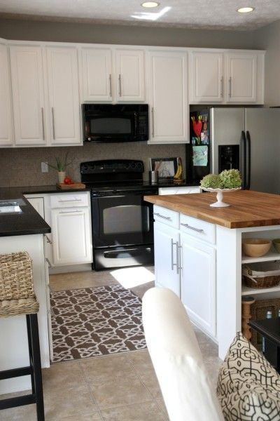 I Love The Combo Of White Cabinets Black Appliances And The Dark
