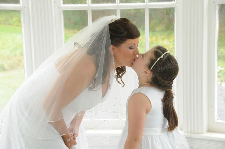 The Bride And Flower Girl Share A Kiss The Pros Wedding Photography Wedding Photography Wedding Bride