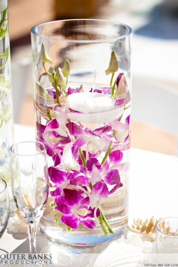 Floating orchid centerpieces are perfect fro 2014 - the year of Pantone's Radiant Orchid