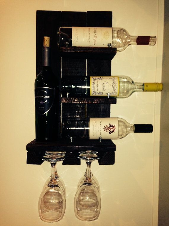This reclaimed wood wall mounted wine rack by WinePalletandMore