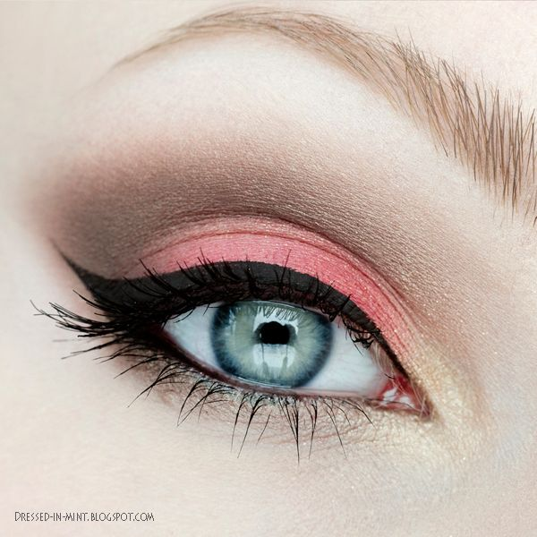Coral, brown, gold eyeshadows with winged liner