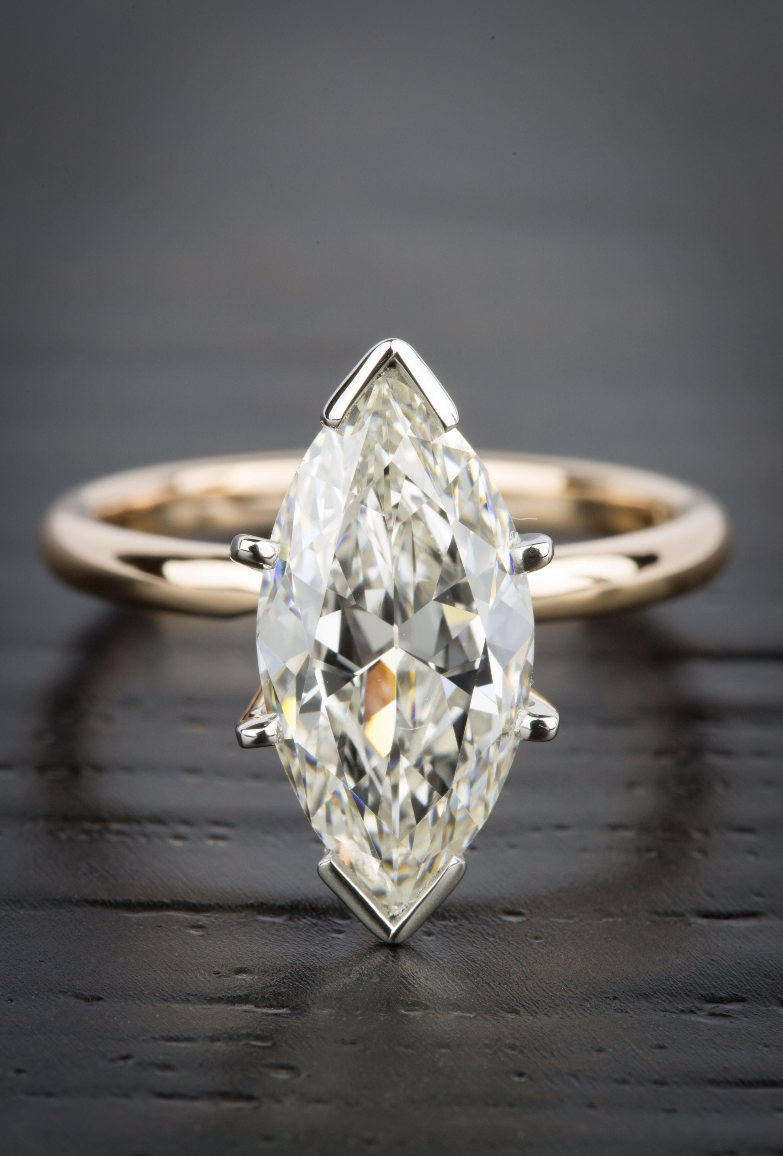 This ComfortFit Marquise Solitaire Diamond