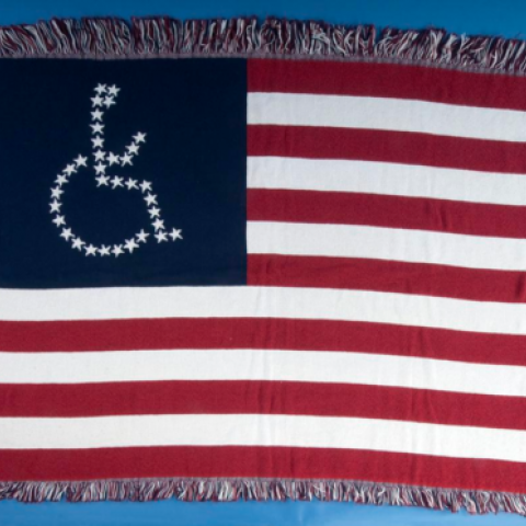 Woven American Flag With Person In Wheelchair Symbol Instead Of Stars History University Of New Mexico Ehlers Danlos