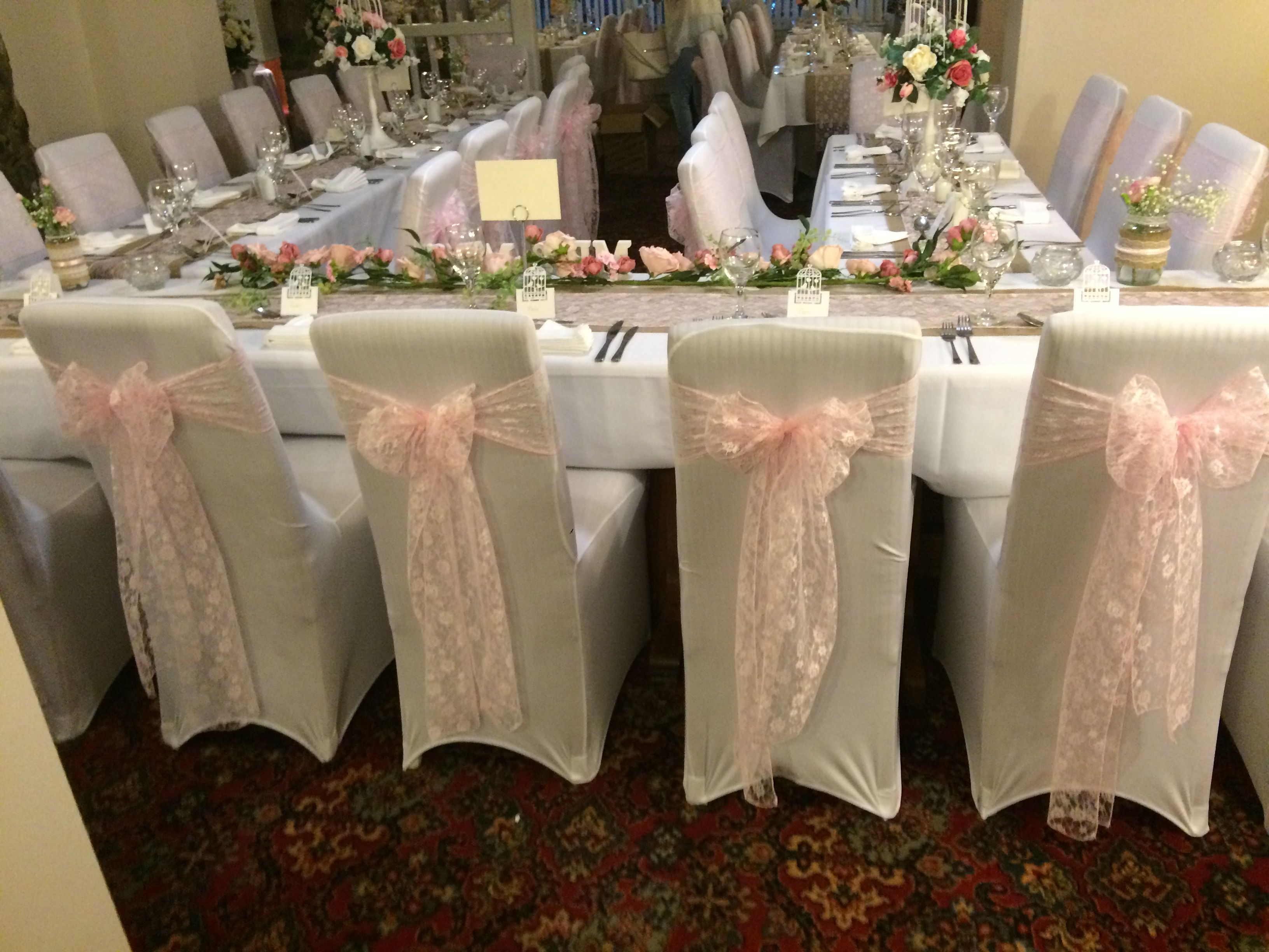 Chair Covers With Pink Lace Sashes Hire In South Wales From Www Affinityeventdecorators Com Wedding Table Settings Fairy Light Backdrops Wedding Hire