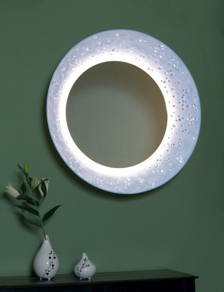 Bodo Sperlein has designed a mirror using not one branded material but two: Corian and Swarovski crystals. Called Eclipse Mirror, the mirror will be launched at Maison & Objet in Paris next month. >> see Sperlein's collection for Lladró in our earlier post. Here's the press release: -- The Bodo Sperlein Eclipse Mirror with DuPont™ …