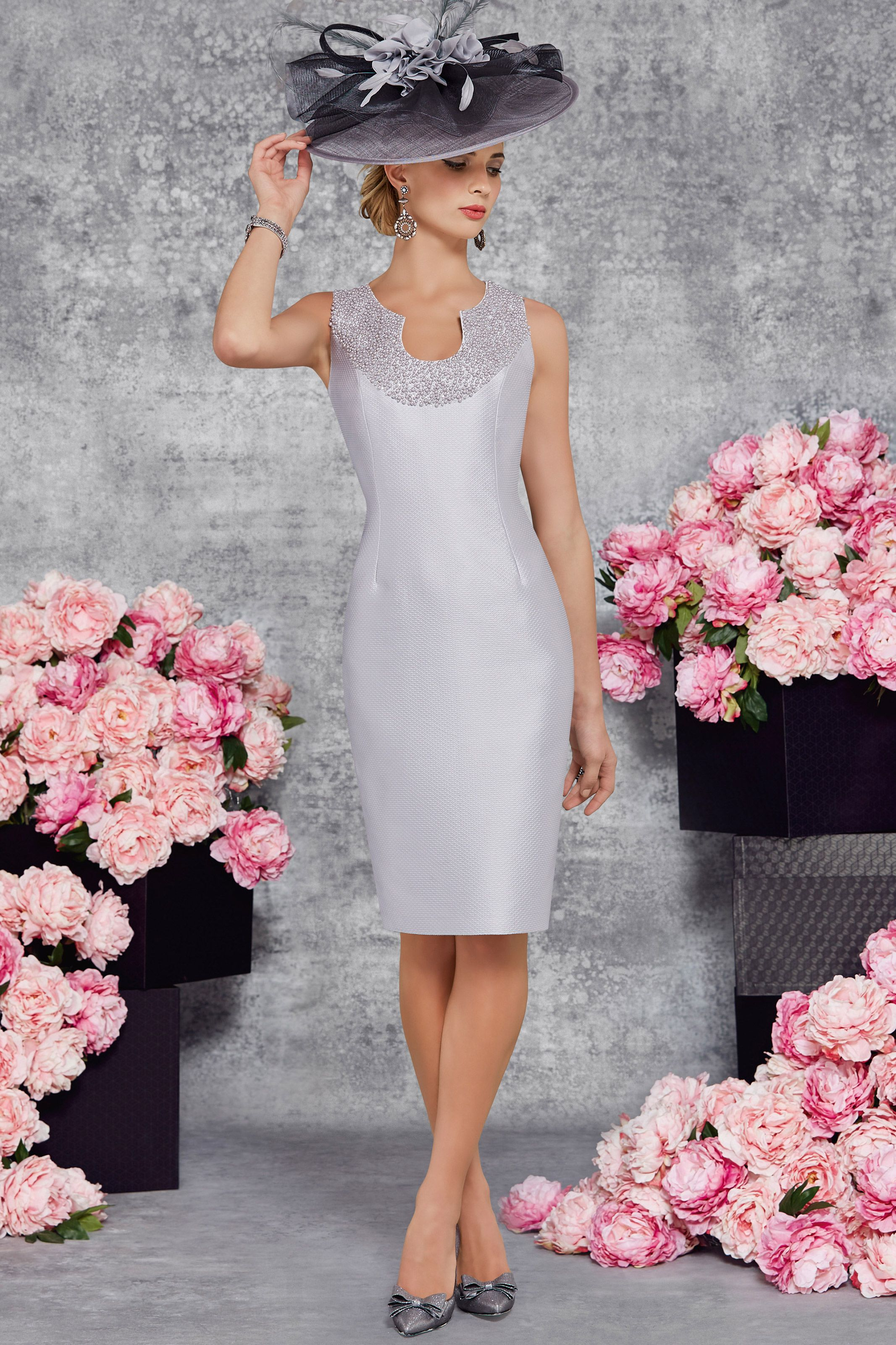 Short fitted dress with pearl detailing and waist length jacket