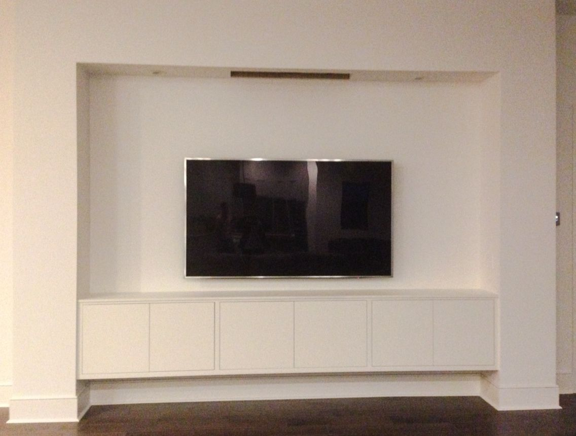 Custom Tv Wall With Built In Floating Cabinet And Hide Away Second