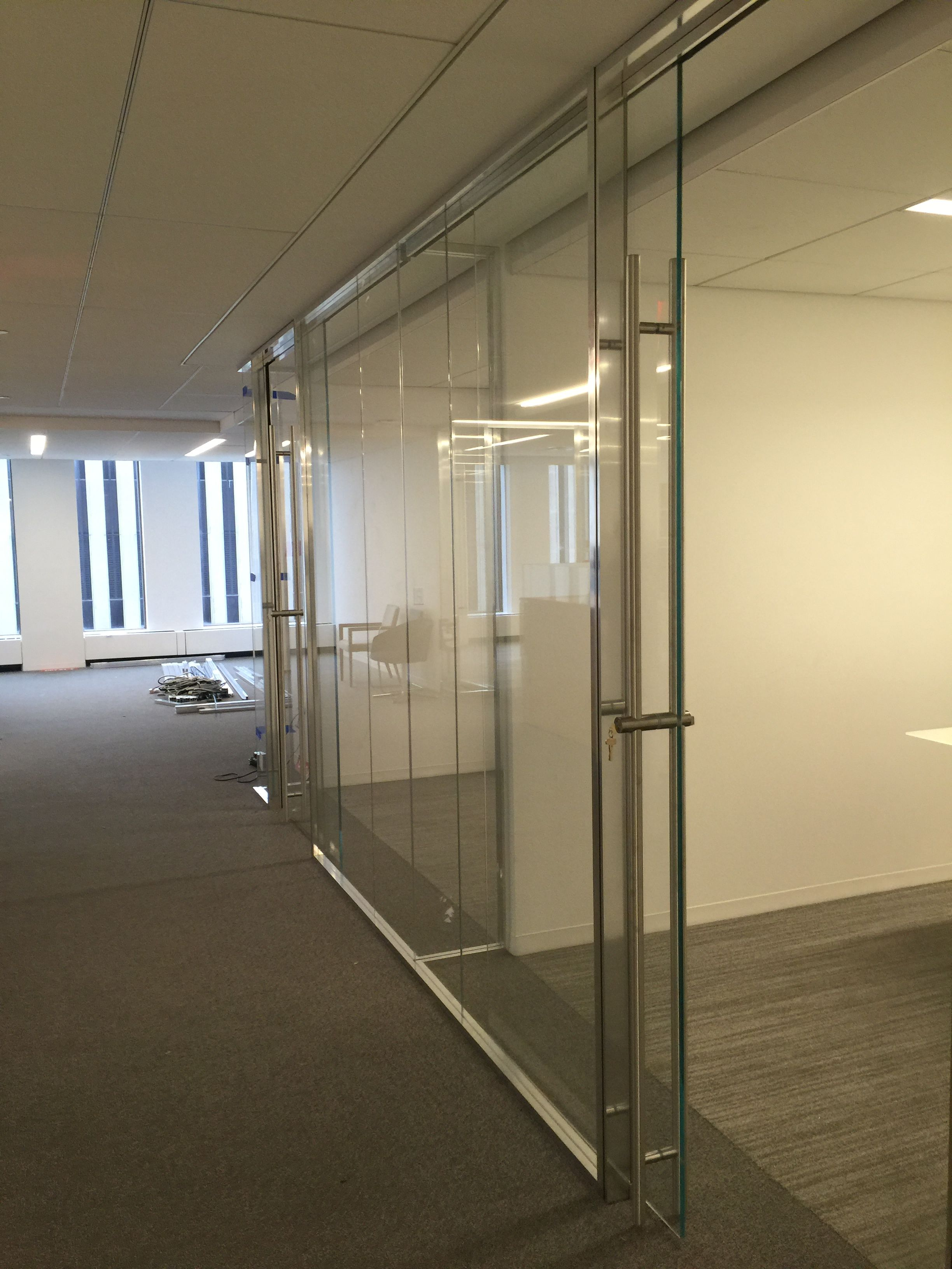 Quantum butt glazed wall system with 1 2 glass and for Sliding window wall