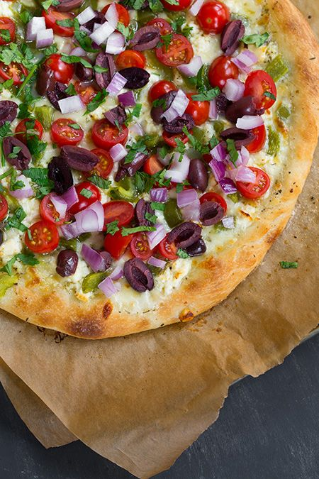 Greek Pizza - covered with feta, mozzarella, grape tomatoes, red onion, bell pepper, kalamata olives, garlic and parsley.  I've never made pizza from scratch but this looks so good I think that's going to change soon :)