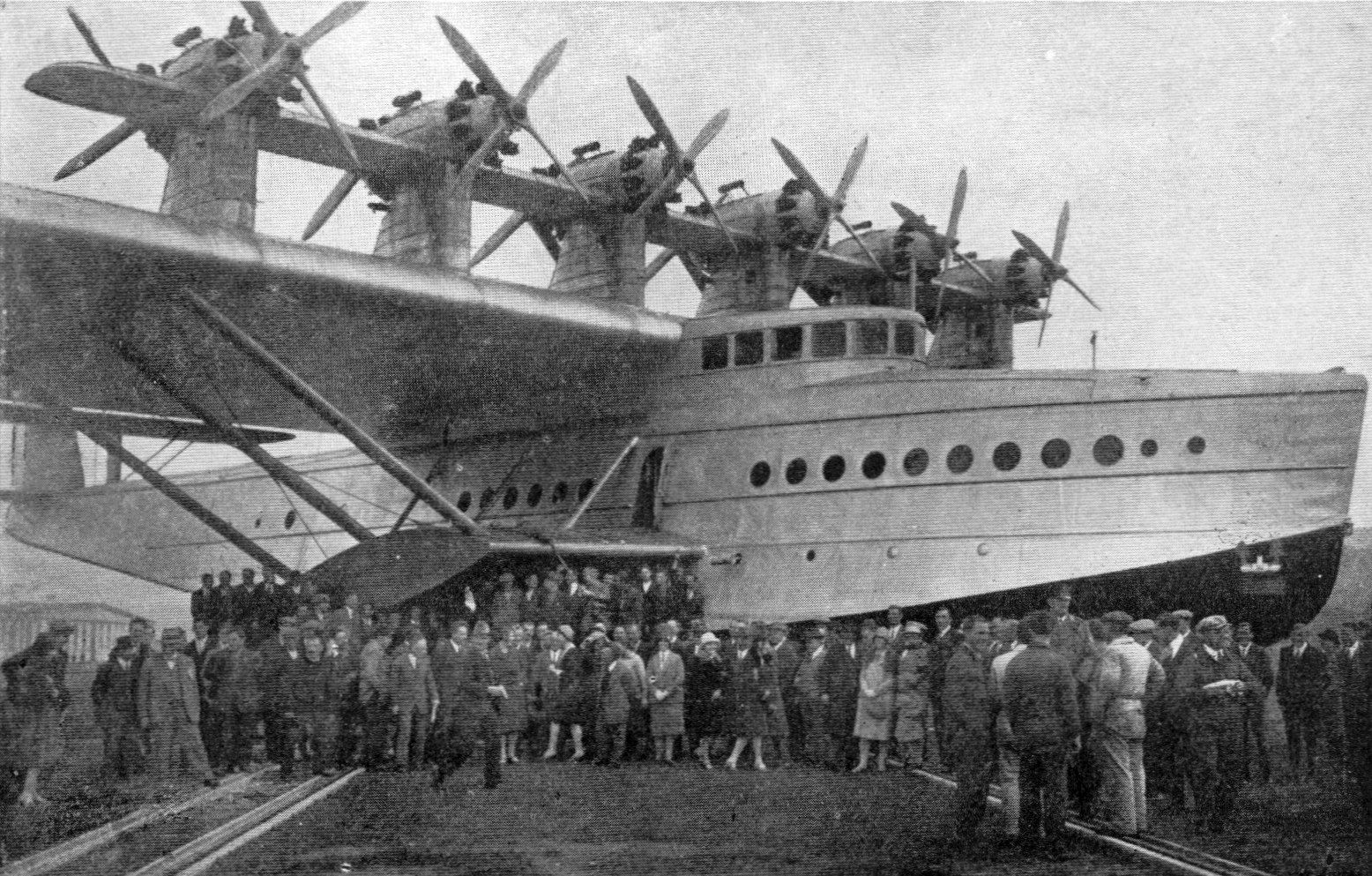 Meanwhile in the real world: Crowds pose with the Dornier Do X aircraft circa mid-1930s. The largest flying boat in the world when first produced in 1929. The luxurious passenger accommodation approached the standards of transatlantic liners.