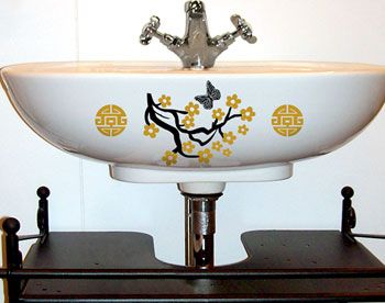 Asian Decal Design Shown On This Unique Sink