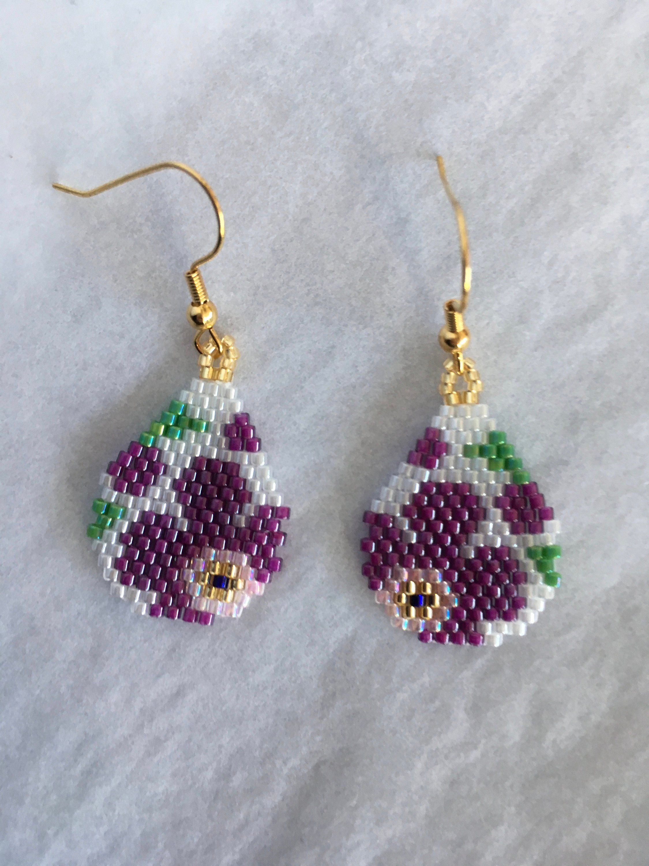 Beaded earrings dangle and drop earrings delica beads flower pattern woven purple flowers green leaves flower earrings pretty earrings #beads