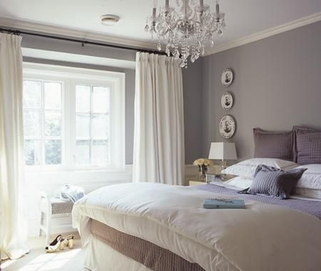 Love the chandelier in this bedroom, slate walls, sheer white ...