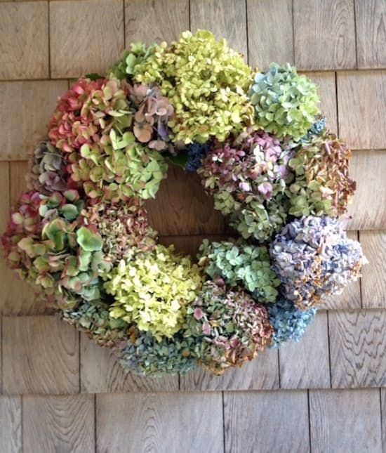 This gorgeous yet simple wreath highlights one of the season's most beautiful blooms—hydrangeas. Use pre-dried bunches in a range of colors so that the wreath will last forever. Follow the instructions on Elements of Style.
