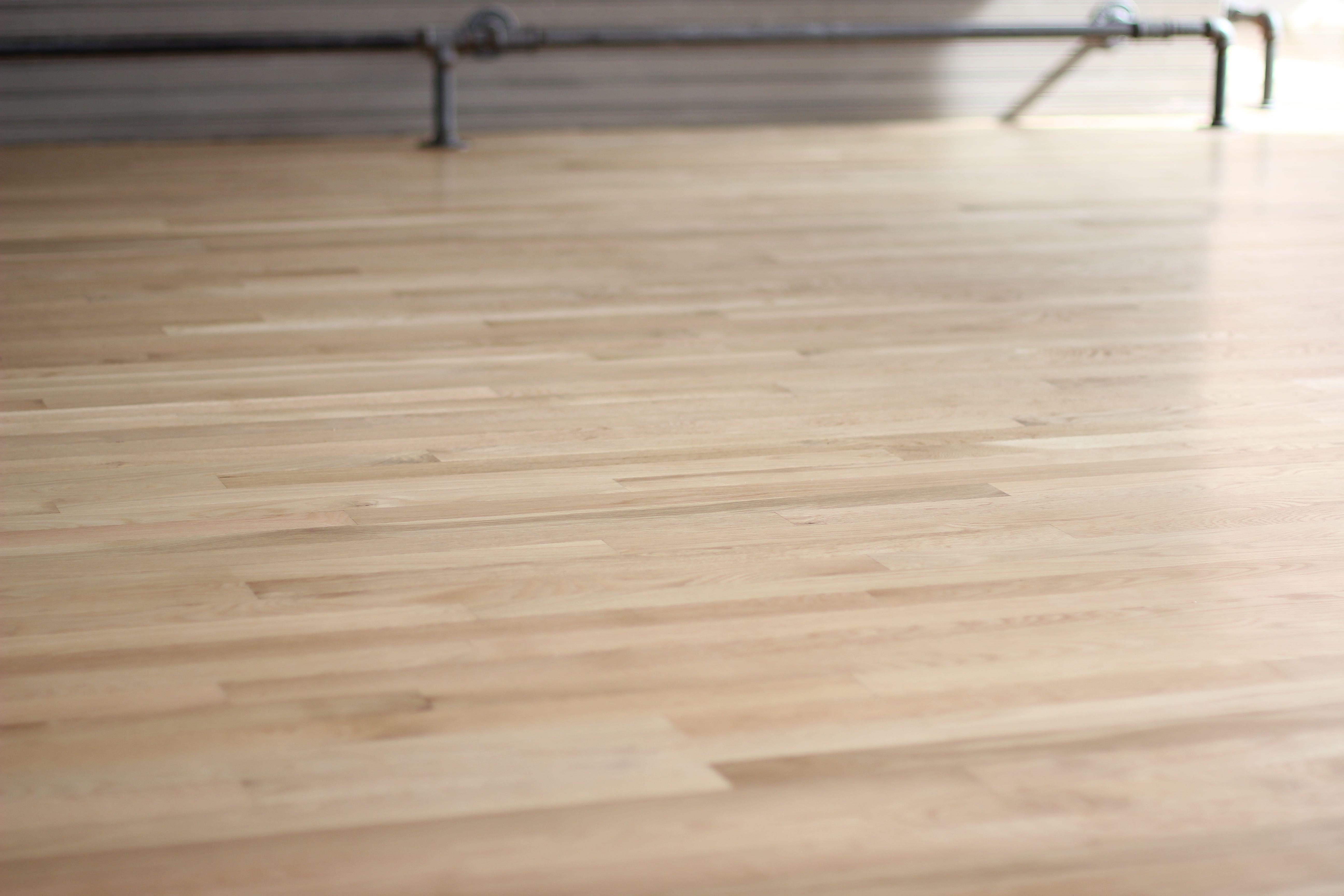 """Natural 2 1/4"""" white oak hardwood flooring with Bona"""