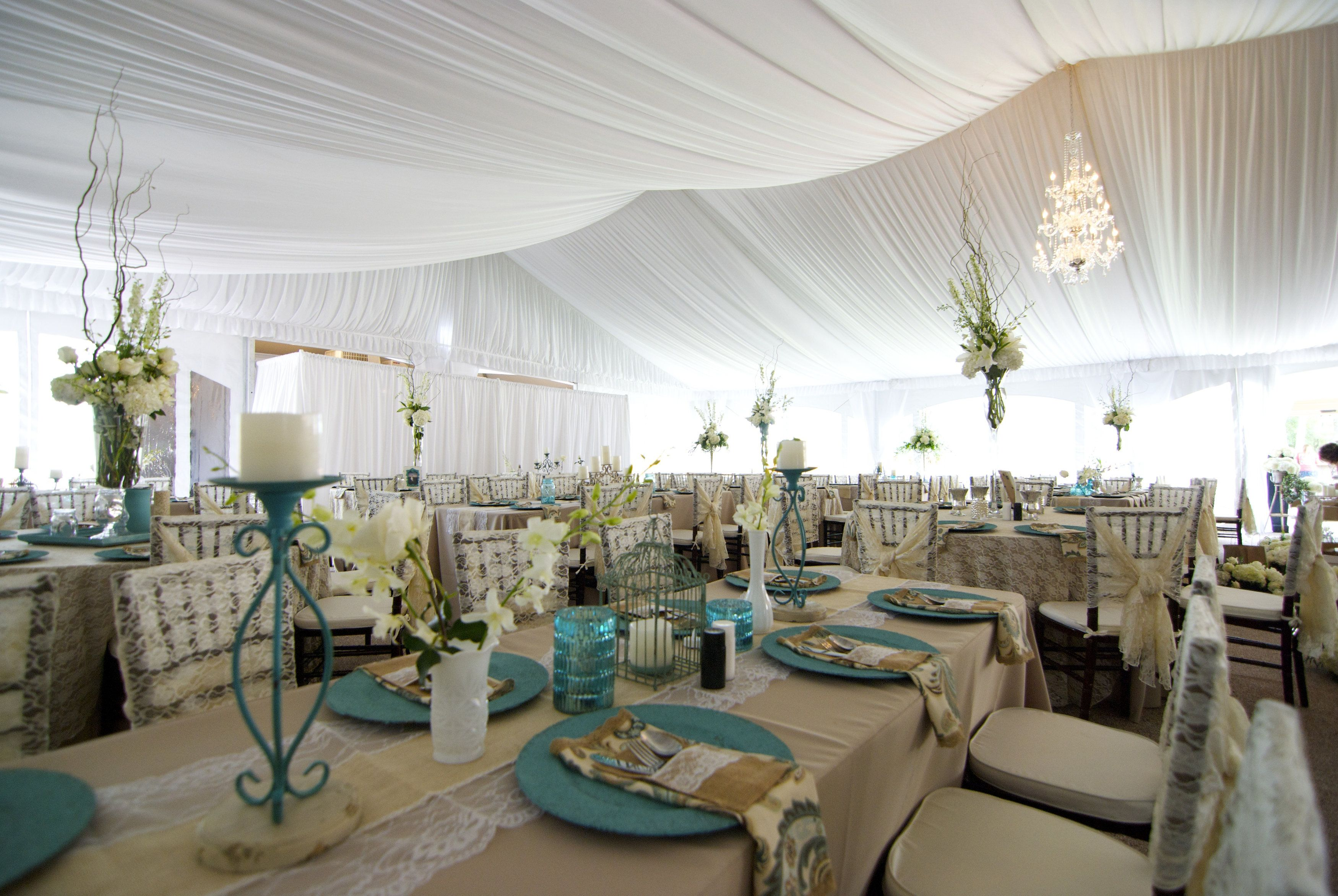 Beautifully elegant rustic wedding reception with blue accents ...