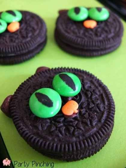 """""""Black Cat Oreo Cookies -- Easy No-Bake Cat Cookies: Oreos, green M&Ms, pumpkin sprinkles, edible marker, and chocolate chips. A simple treat for a Halloween party!"""