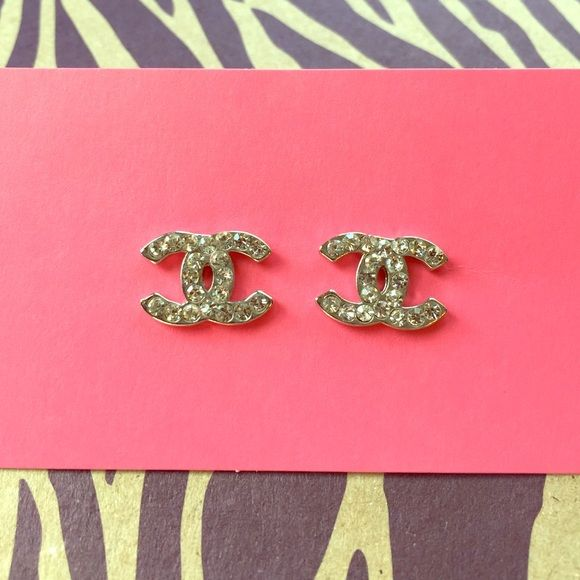 Designer-inspired sparkly post earrings. Of course these are NOT true Chanel but cute all the same! Pair of silver rhinestone post earrings inspired by the Chanel logo. Gently used, everything still intact. Jewelry Earrings
