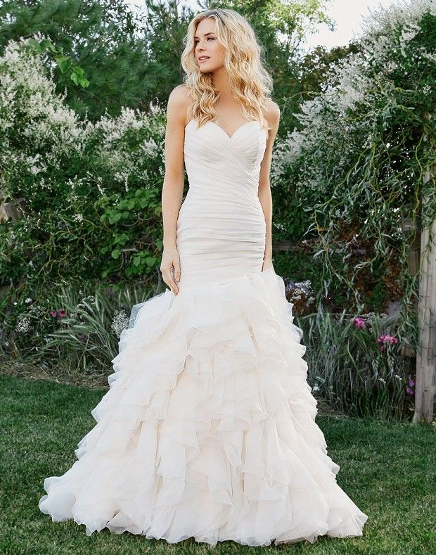With its sweetheart neckline, mermaid silhouette, ruffle skirt, and ...