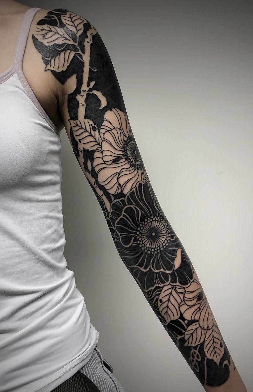 These Striking Solid Black Tattoos Will Make You Want To Go All In Solid Black Tattoo Black Sleeve Tattoo Tribal Sleeve Tattoos