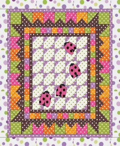 So want to do this quilt!! Love the polkadots!!
