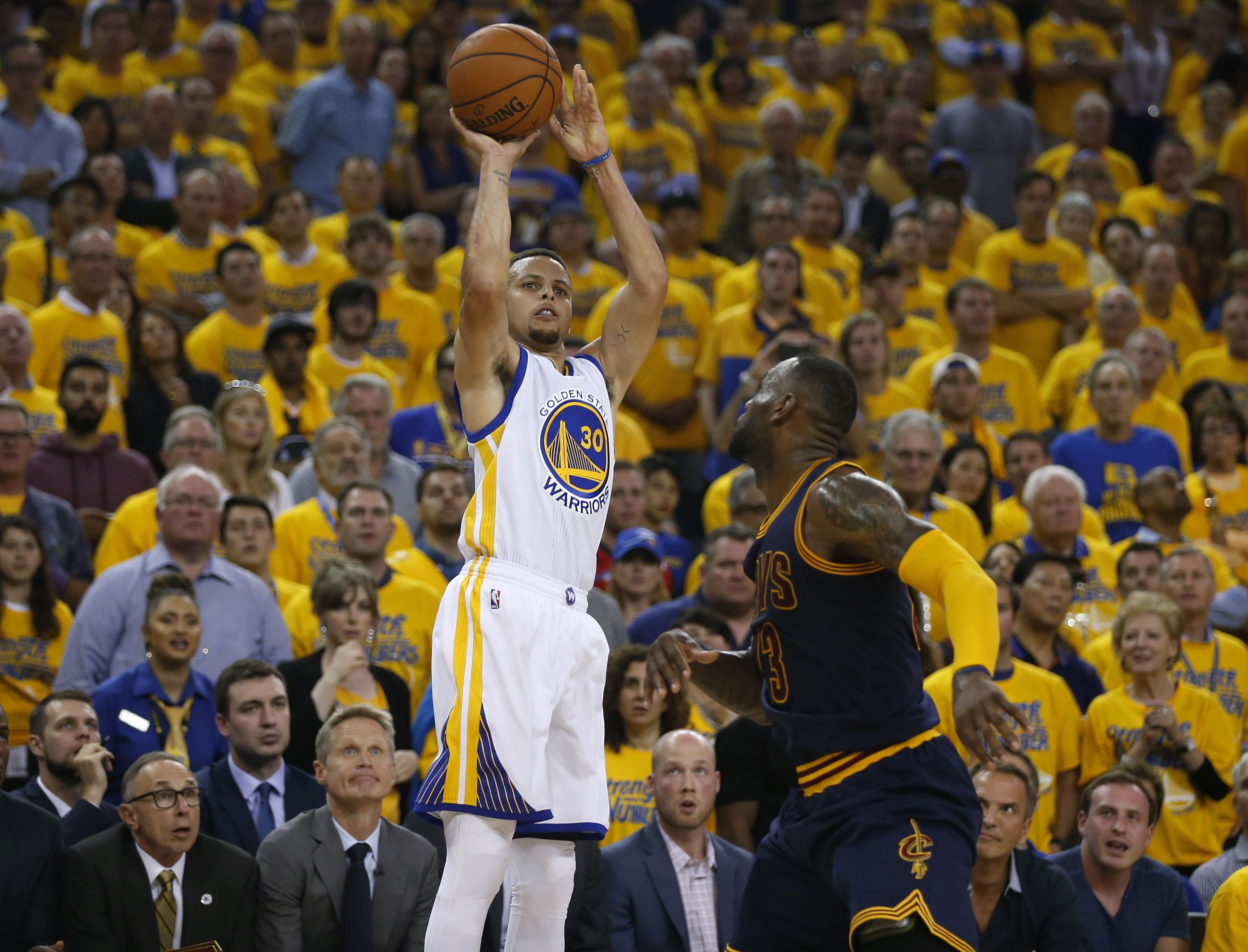 Stephen Curry shooting a 3 pointer over Lebron James fb3c4ed411a7