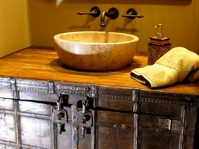 Repurposed metal trunk transforms into a bathroom vanity. Cool idea.