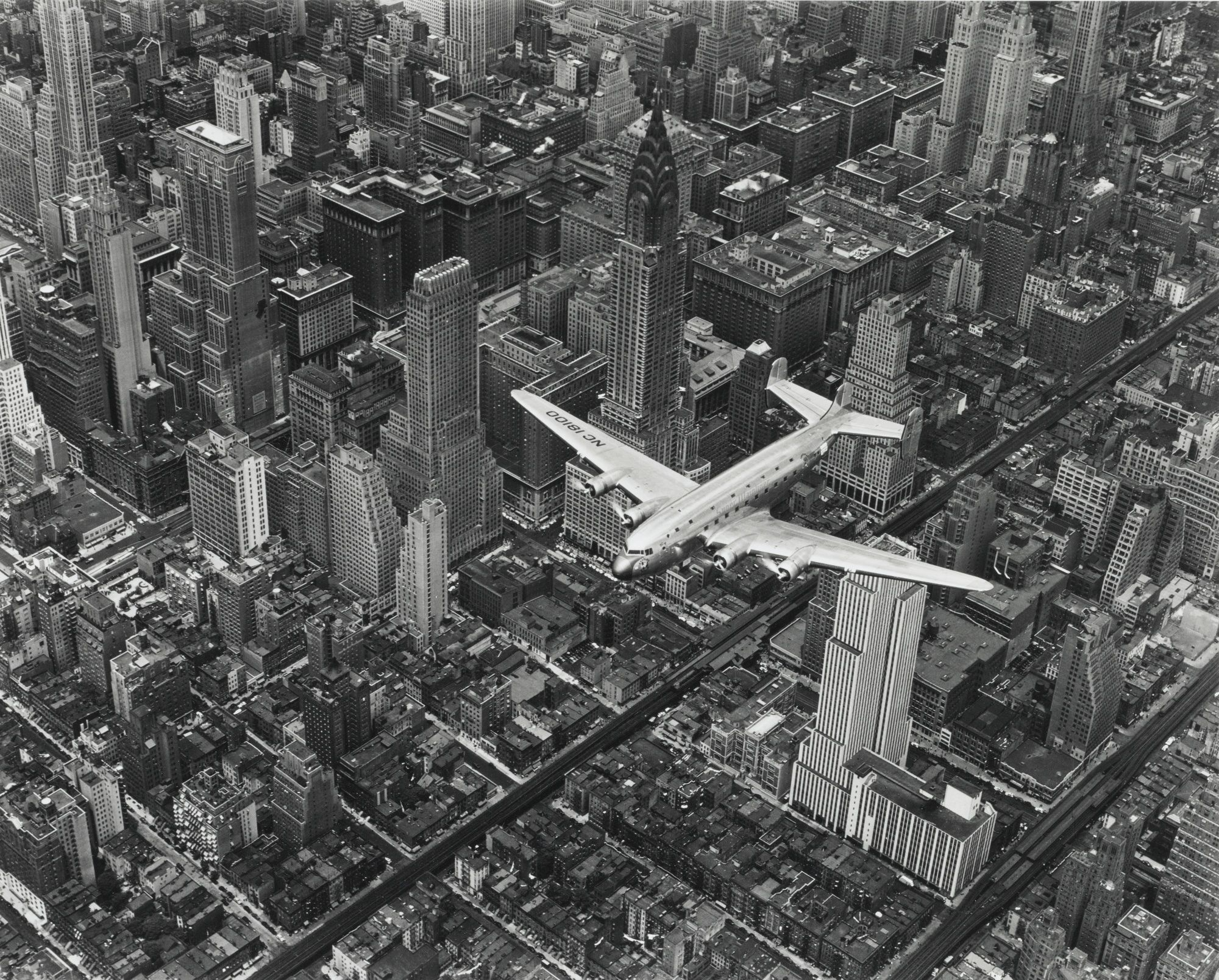 DC4 Flying Over New York City, 1942 by Margaret Bourke