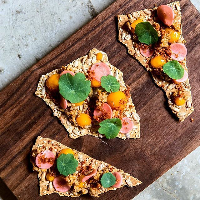 """Chorizo egg yolk gel pickled radish brown butter crumble nasturtiums. """"It tastes like breakfast... But better."""" -  @whentheyfindus at last week's #junokimcatering x @33acresbrewing. Tomorrow come celebrate 33's second birthday! I'll be serving up two flavour bombs as complimentary canapés: Shiitake x konbu crackers with pork belly kimchi mayo shaved daikon.  Spicy ramen crackers with fried broccoli Gruyère x Parmigiano Mornay nori. Shout out to @merchantsvan for the inspo! by jun0k"""