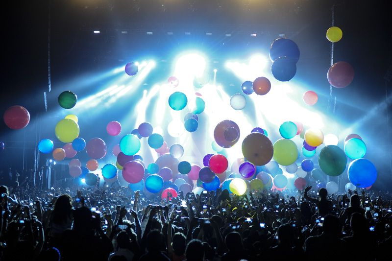 Balloons around the stage during a concert.