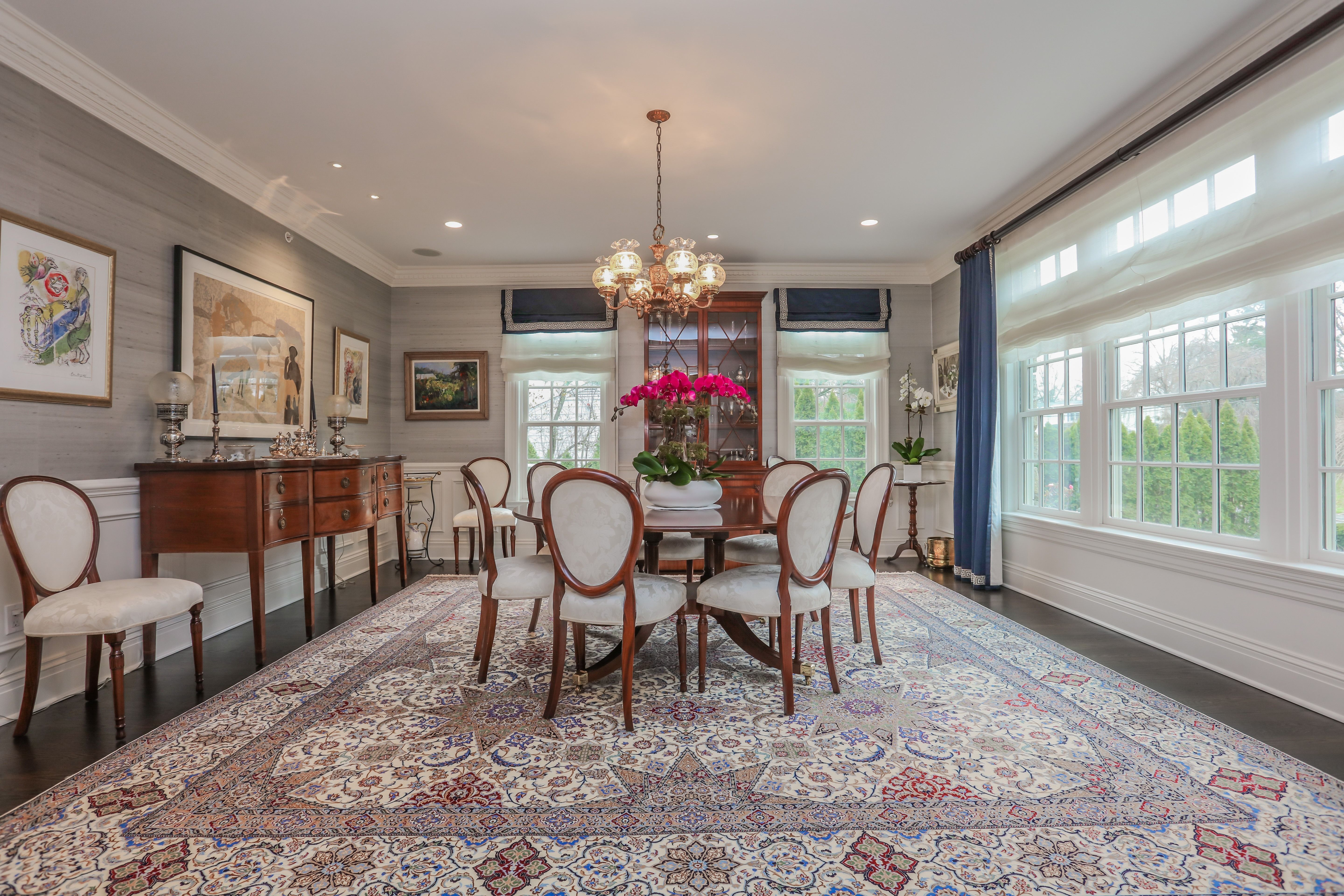 Wainscoting formal dining room - Formal Dining Room With Wainscoting And Large Banks Of Transom Windows