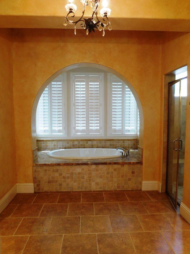 2 story master bedroom  Master bathroom with his u hers separate wood grain vanities stone