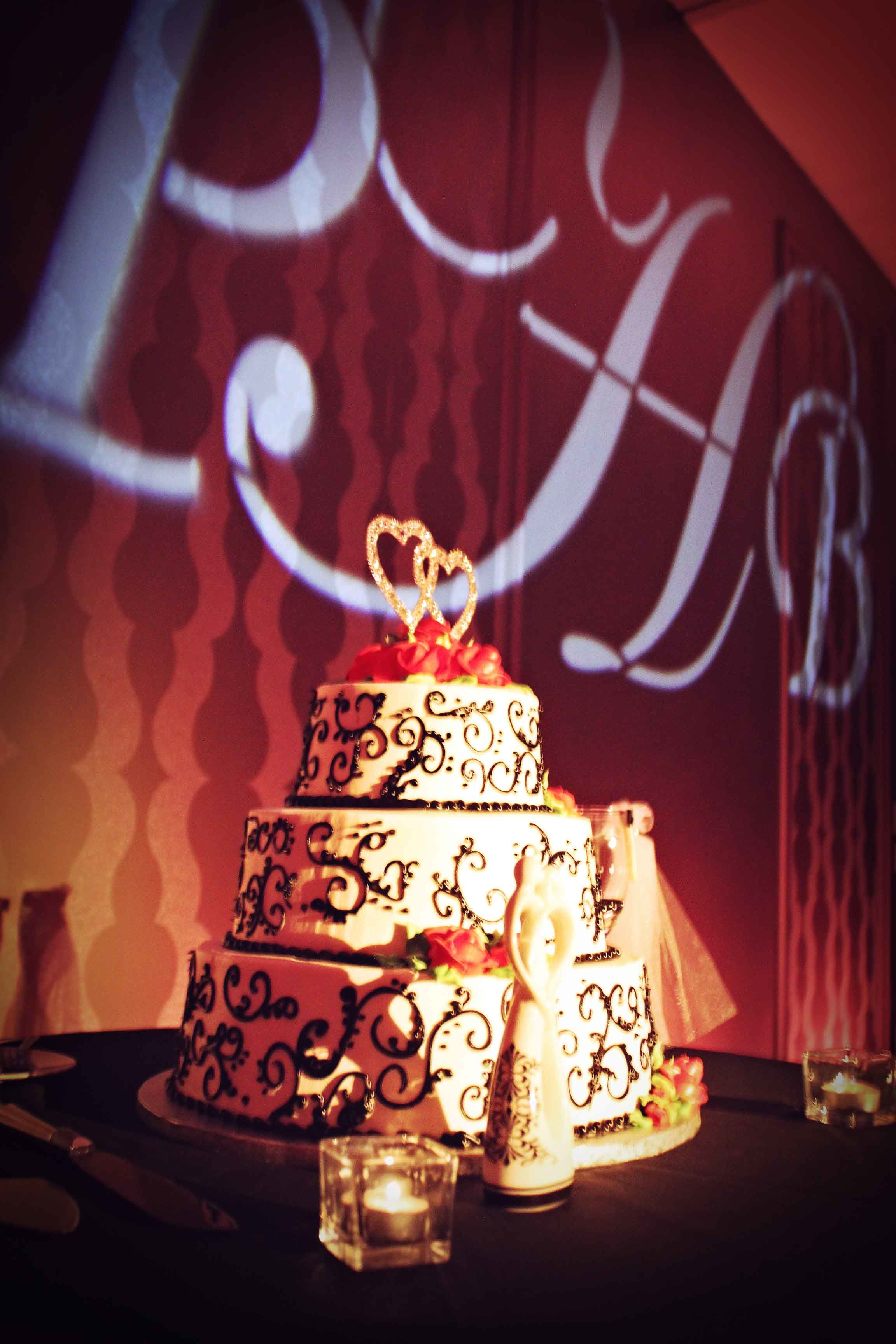 Love this setup of a #weddingcake and #gobo #monogram with beautiful #uplighting at this #wedding #reception! #diy #diywedding #weddingideas #weddinginspiration #ideas #inspiration #rentmywedding #celebration #wedding #reception #party #wedding #planner #event #planning #dreamwedding