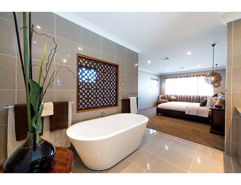 We love the open plan design of this bedroom and bathroom