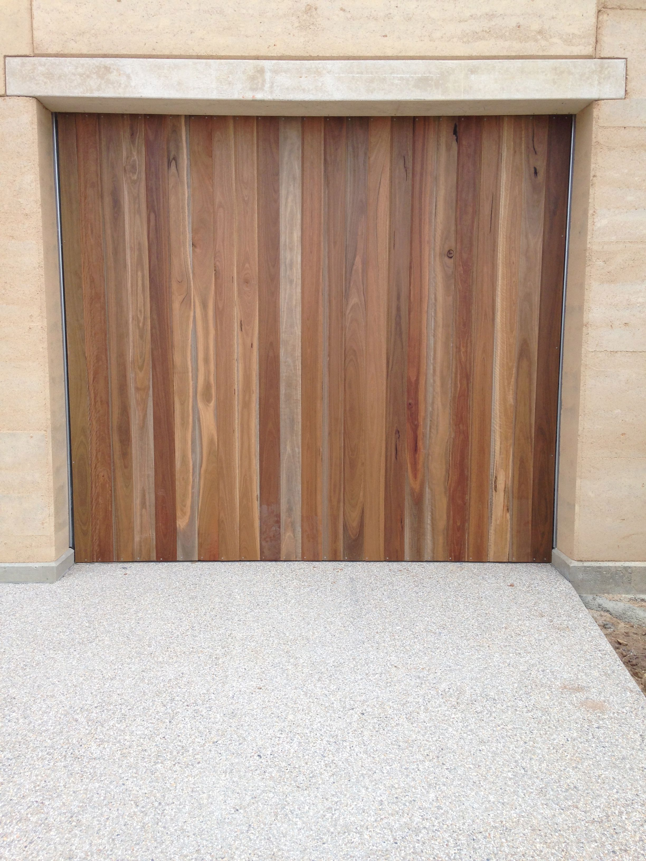 custom tilt panel spotted gum garage doors