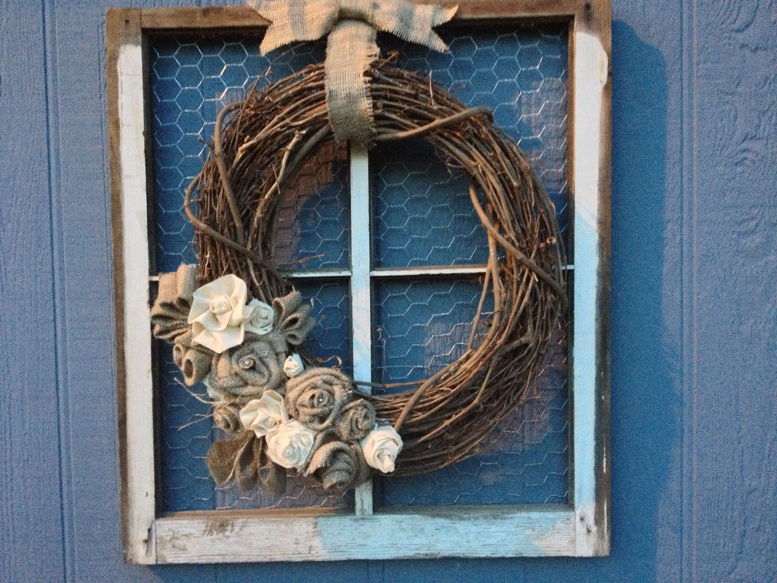Old window craft.. Grapevine wreath with burlap and cotton flour sack roll-it roses.. Super easy craft!!