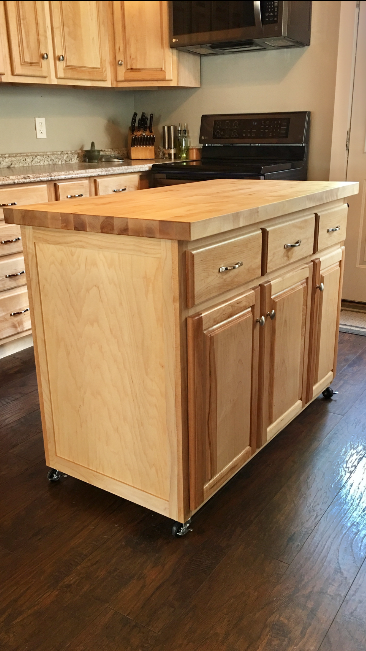 Kitchen Island On Wheels Made Of Solid Maple With A Butcher Block