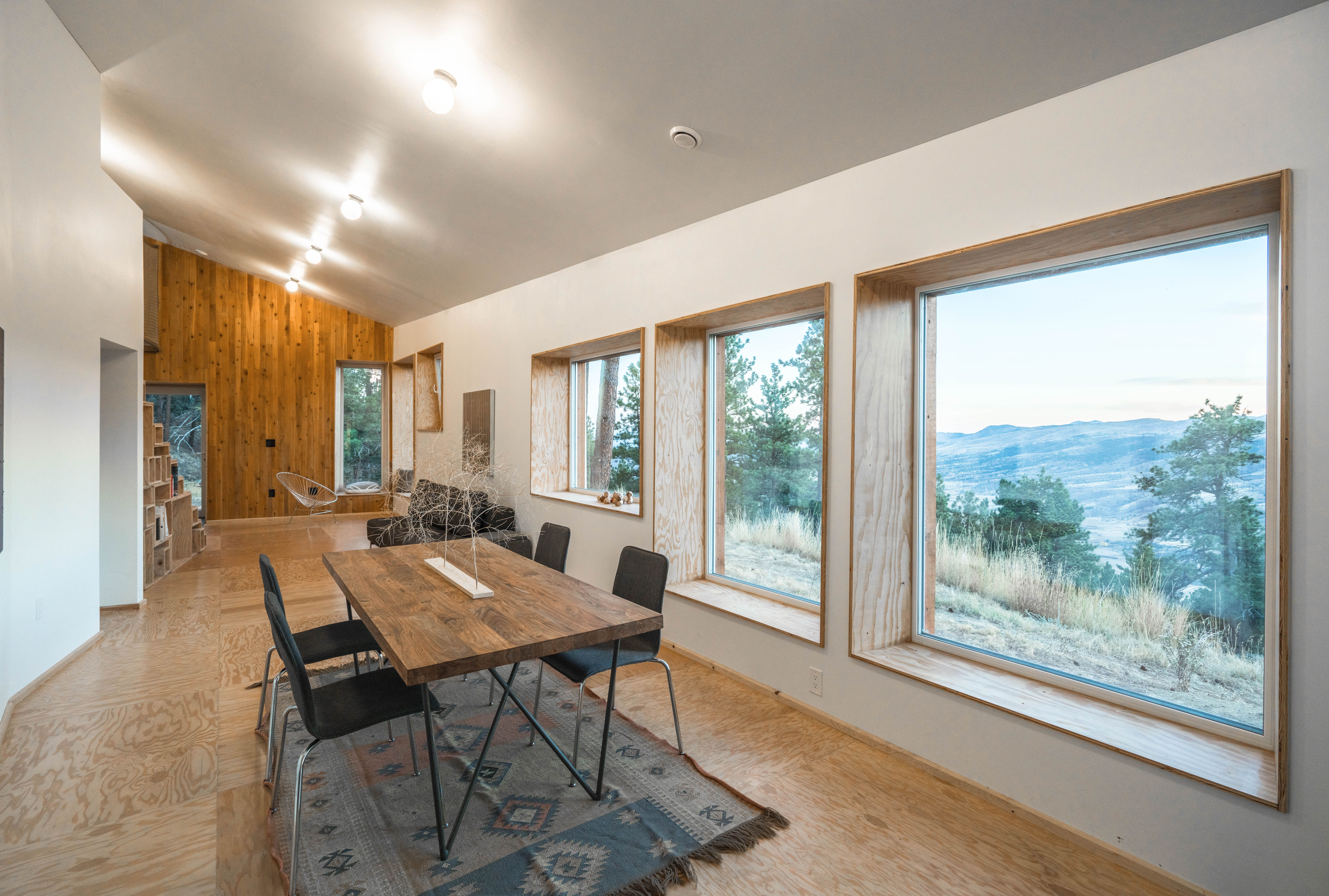 Passive house dining area looking out at beautiful mountains