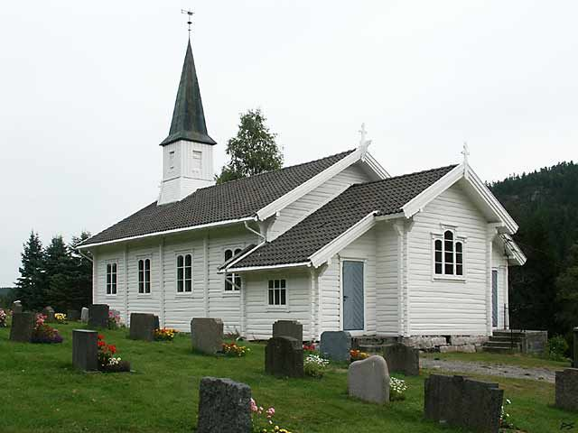 The Kroken church from 1909 is constructed from joined (notched) logs and painted white. North of   Kragerø, at the road from Sannidal to Neslandsvatn
