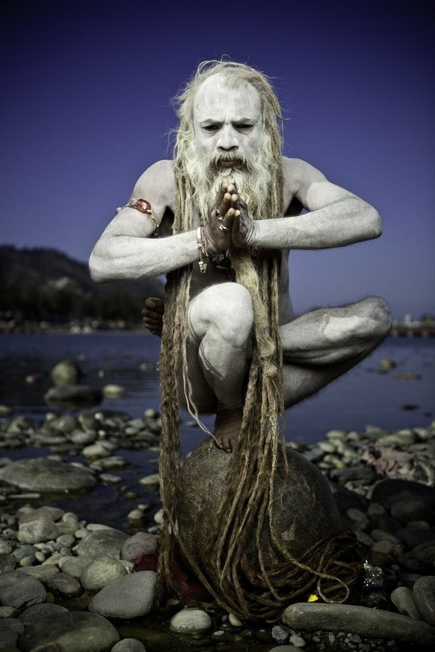 A naked Sadhu in his Yoga practice on the banks of the ...
