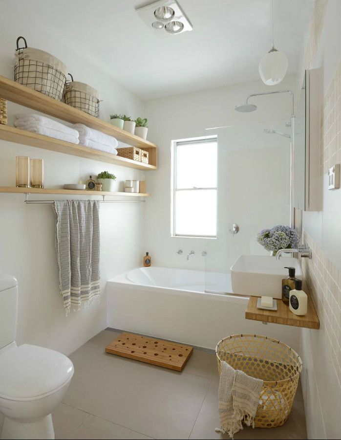 an easy diy to add storage to a small bathroom just putting up some high shelves to store towels and baskets to hold smaller items
