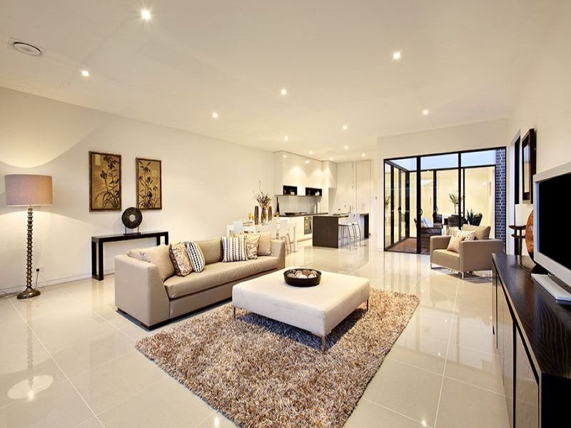 Open Plan Living Room Using Beige Colours With Tiles Floor To Ceiling Windows