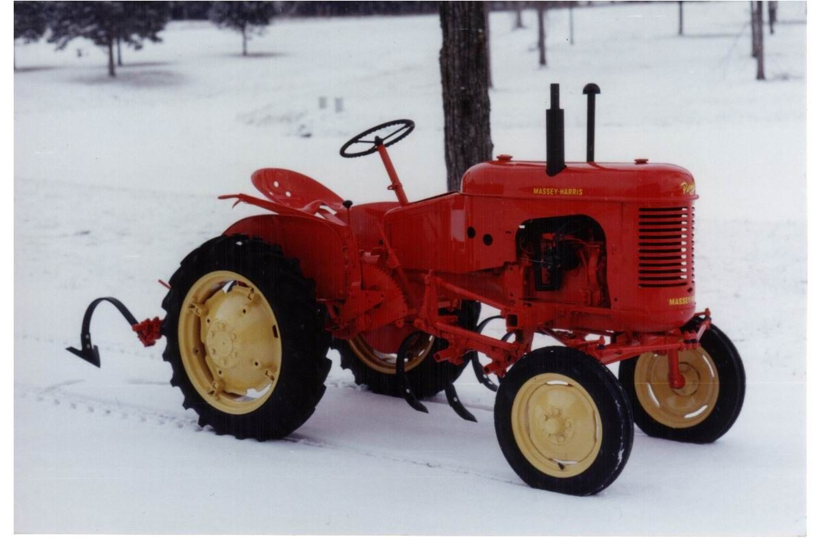 Massey harris pony playing in the snow tractors ford