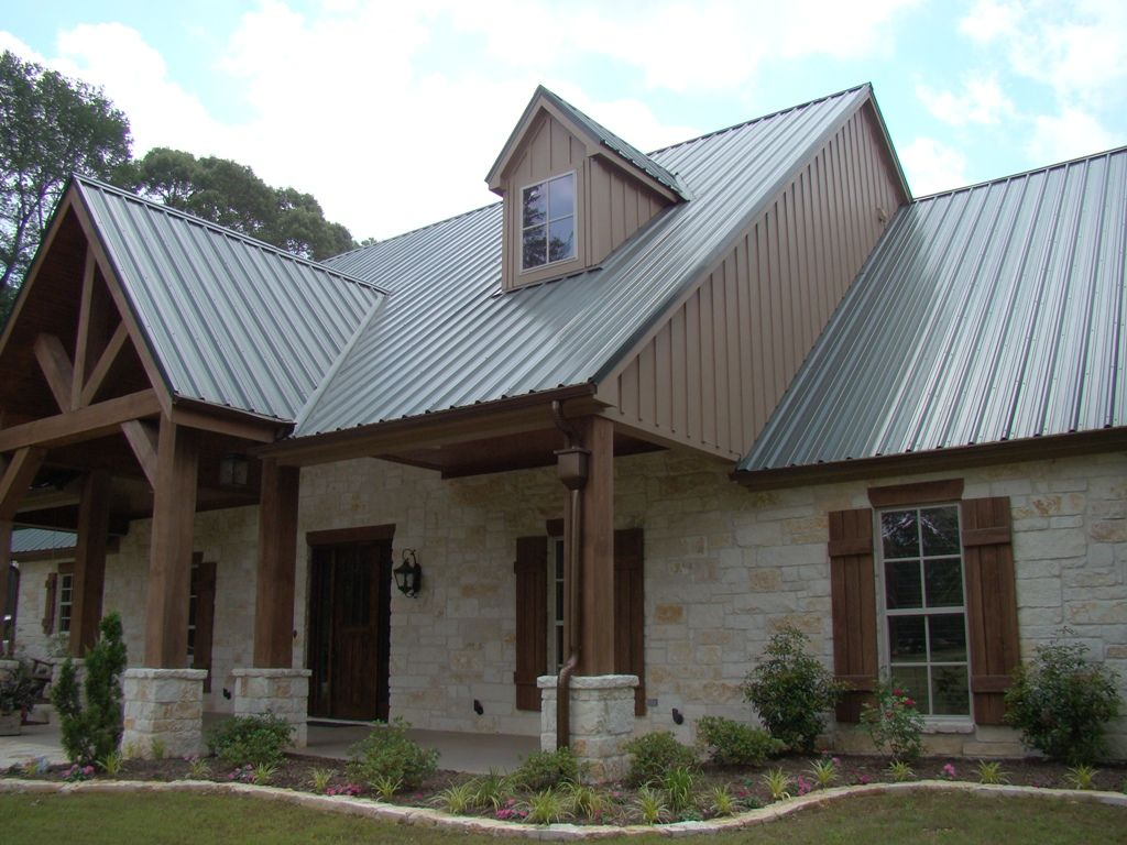 A Lovely Texas Hill Country Style Home Featuring Native Texas Limestone Cedar Beams And Tin Roof De Metal Roof Houses Limestone House Metal Building Homes